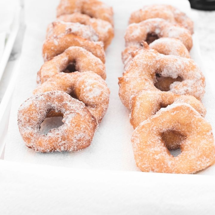 My memories of making these Filhoses (or Portuguese Doughnuts) with my grandma are some of my best memories! Here's how I make this yummy nostalgic treat! #tulipandsage #portuguesedonuts #malasadas #filhoses