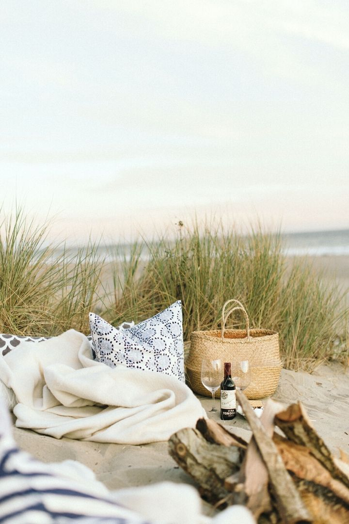 Photo Credit - ruemag.com // I'm craving some sunshine.  And I'm currently daydreaming of a beach picnic!  If you share in this daydream, here's some serious beach picnic inspo for ya! #tulipandsage #beachpicnic #beachpicnicaesthetic #beachpicnicideas