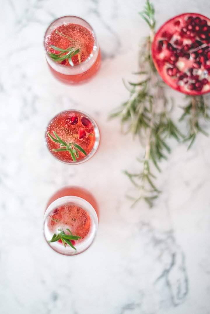 Happy New Year! This simple and festive Pomegranate Champagne Cocktail recipe is the perfect little drink to sip on this New Year's Eve. #pomegranatechampagnecocktail #champagnecocktailspomegranate #champagnecocktailsnewyearseve #champagnecocktailrecipes